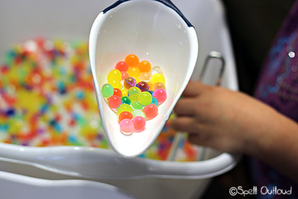scooping water beads
